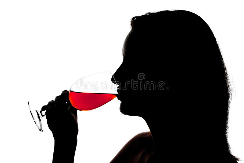 Silhouette of woman degusting wine stock photo