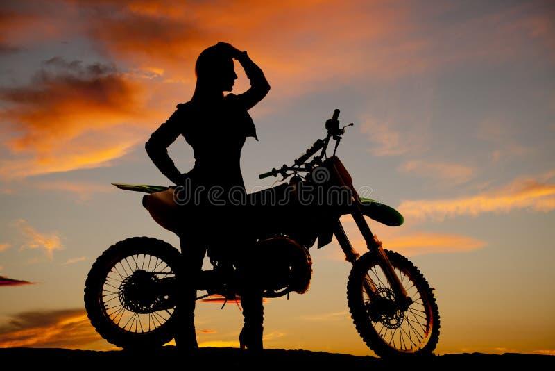 Silhouette woman by dirt bike hand head stock image