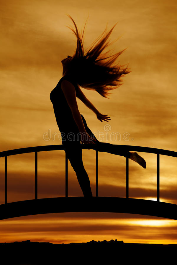 Silhouette of woman hair flying leg back royalty free stock photo
