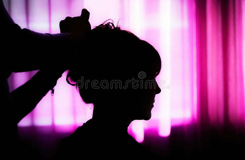Silhouette Of A Woman At The Hairdresser royalty free stock photography