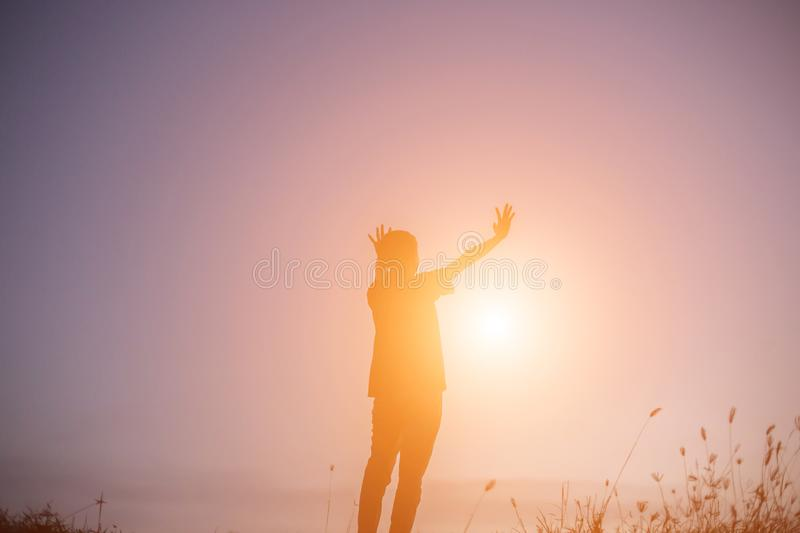 Silhouette Woman hands sunset stock image