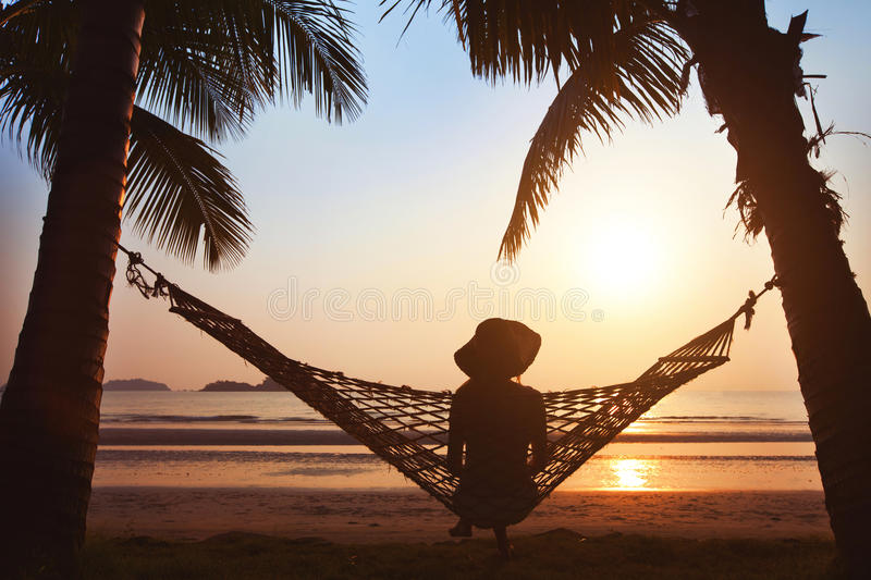 Silhouette of woman in hat royalty free stock image