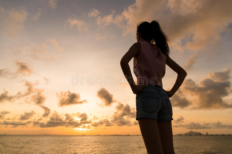 Silhouette of woman holding hand on waist. Asian young woman stock image
