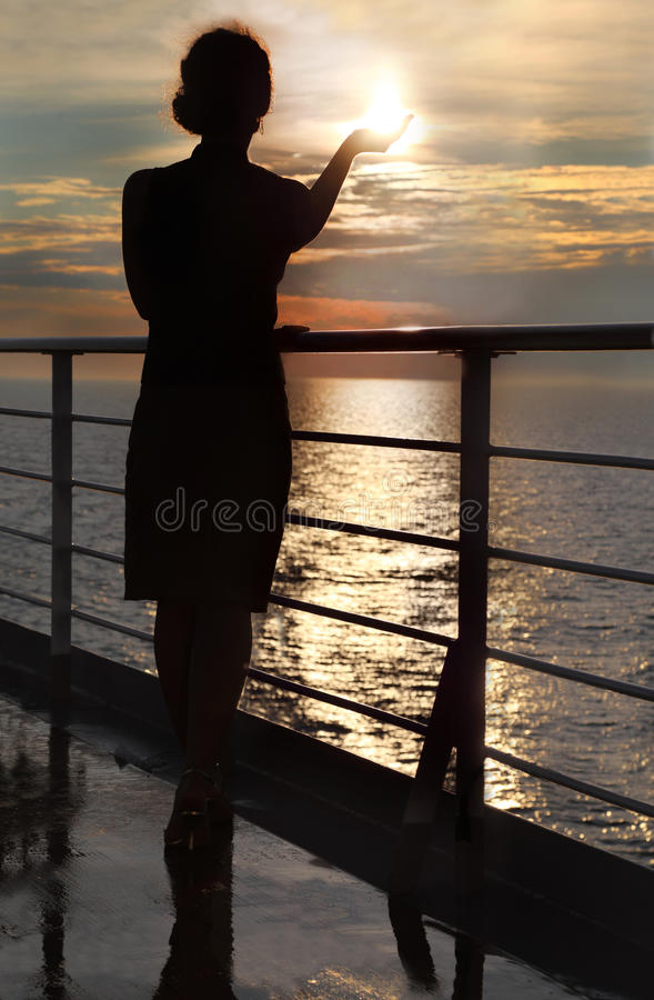 Download Silhouette Of Woman Holding Sun, Standing On Deck Stock Photo - Image: 26337580