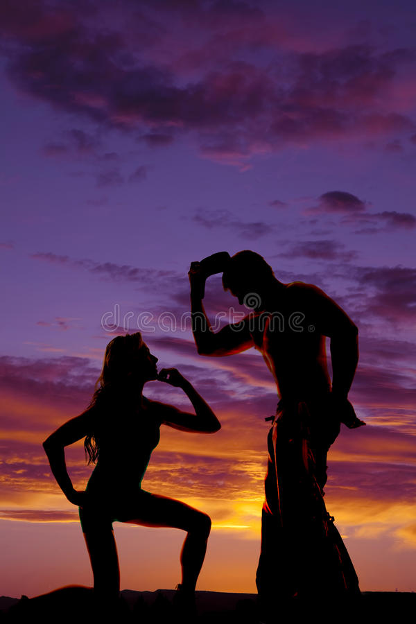 Silhouette of woman on knee look up at cowboy royalty free stock photo