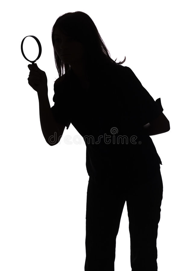 Silhouette of woman with magnifying glass stock photos