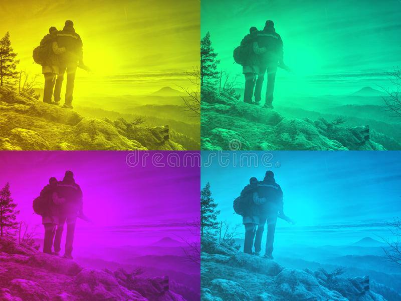 Silhouette woman and man at sunset on top mountain. Silhouette women and men at sunset on top mountain. Relax time travel on holiday Abstract filter, wonderful stock photos