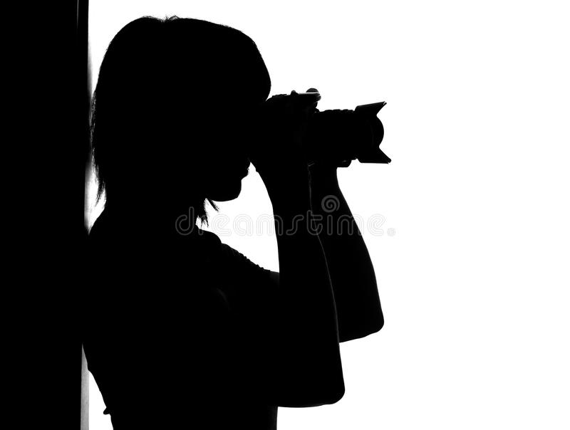 Silhouette of woman with photo stock photo