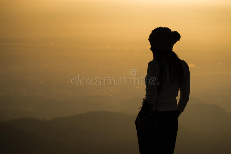 Silhouette of a woman photographer standing stock image