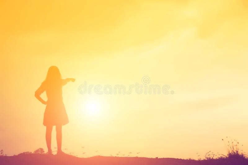 Silhouette of woman praying over beautiful sky background royalty free stock photography