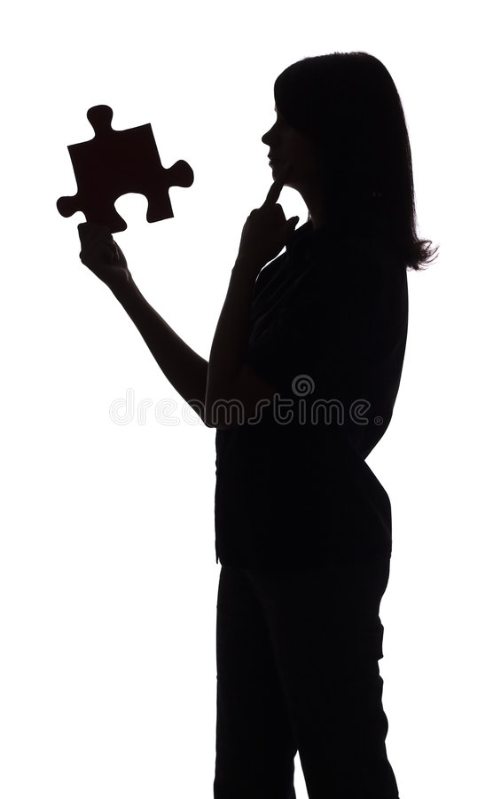 Silhouette of woman with puzzle stock photos