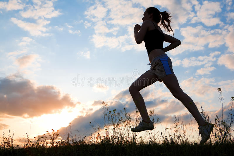 Silhouette Woman Run Under Blue Sky Royalty Free Stock Photos