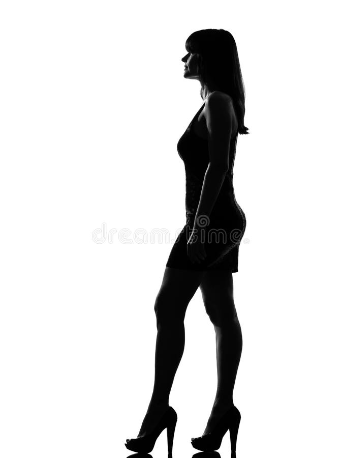 Silhouette woman standing profile full length stock image