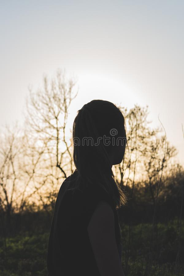 Silhouette of Woman during Sunset stock photos