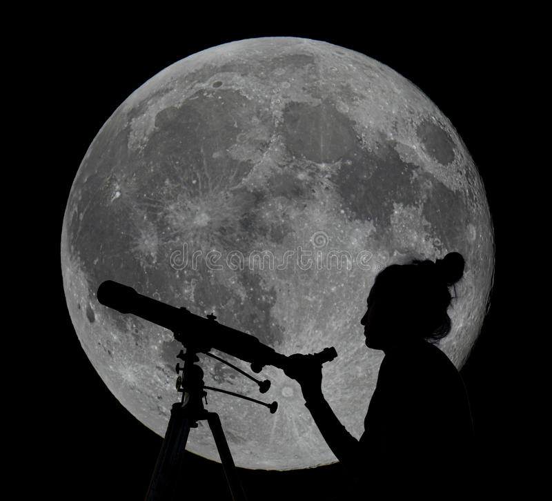 Silhouette of a woman with telescope Moon Observing stock photo