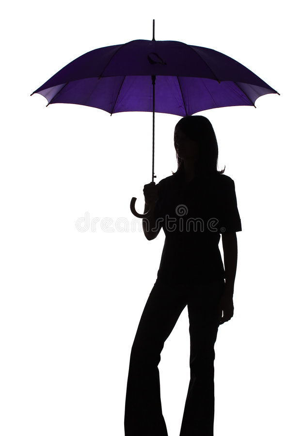Silhouette of woman with umbrella stock photography