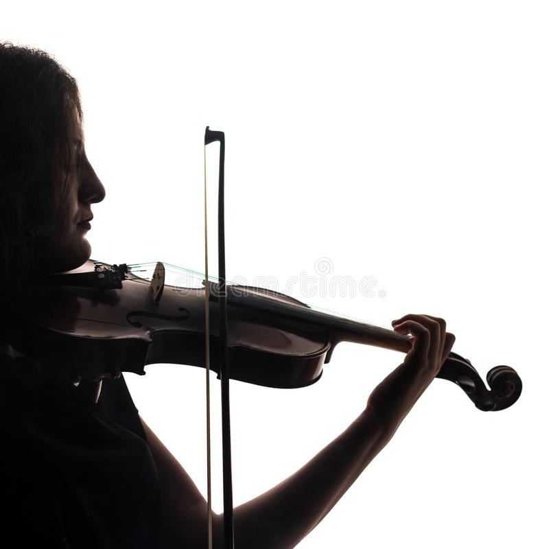 Silhouette of a woman violinist. Square. Close-up. Violin and bow in musical hands. royalty free stock photo
