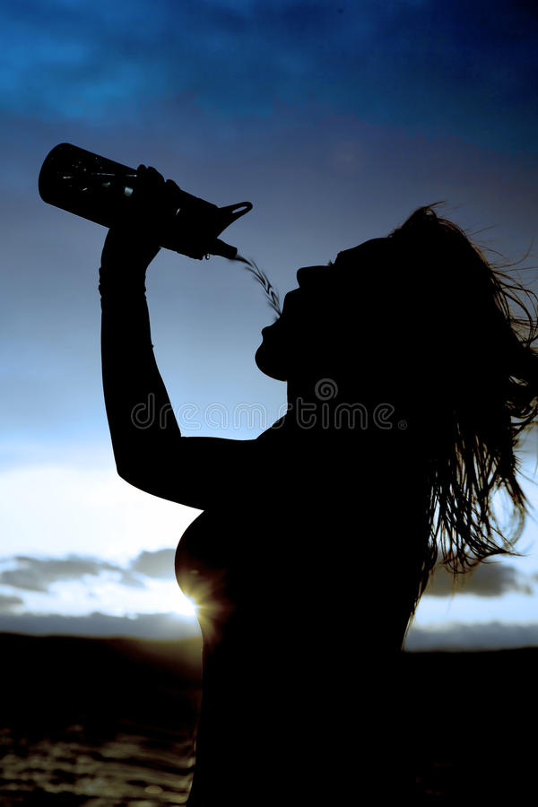 Silhouette of a woman and water bottle stock photos