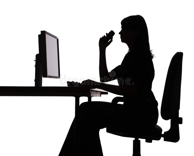 Silhouette of woman working computer (phone). Isolated on white silhouette of woman working computer + cell phone royalty free stock photo