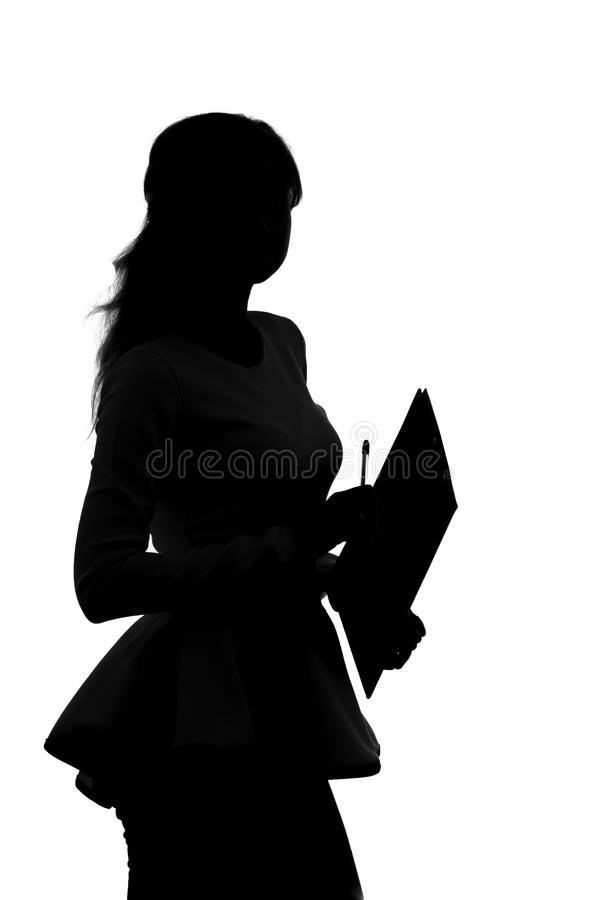 Silhouette of a woman working in an office with a folder for sheets and a pen in the hands. Black and white silhouette of a woman working in an office with a stock images