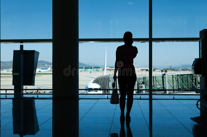 Silhouette of women in airport terminal stock photo