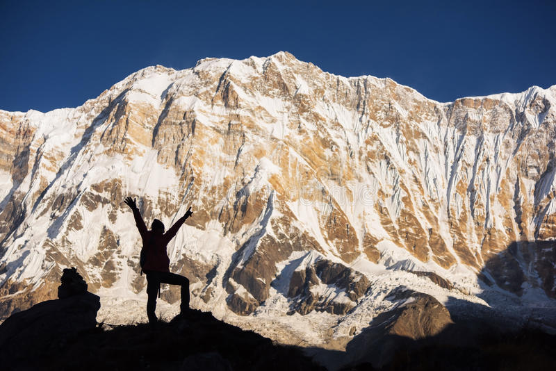 Silhouette women backpacker on the rock and Annapurna I Background 8,091m from Annapurna Basecamp ,Nepal. Silhouette women backpacker on the rock and Annapurna stock photography
