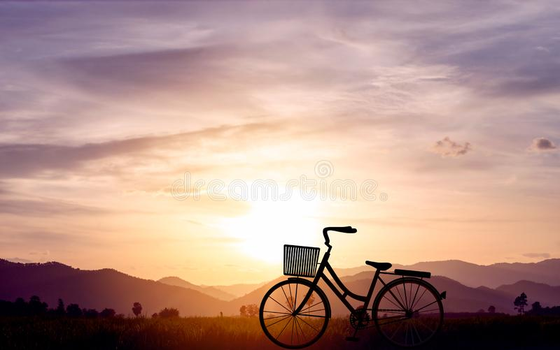 Silhouette women bike at sunset on mountain hills and sky cloud. Vector illustration design.  stock illustration