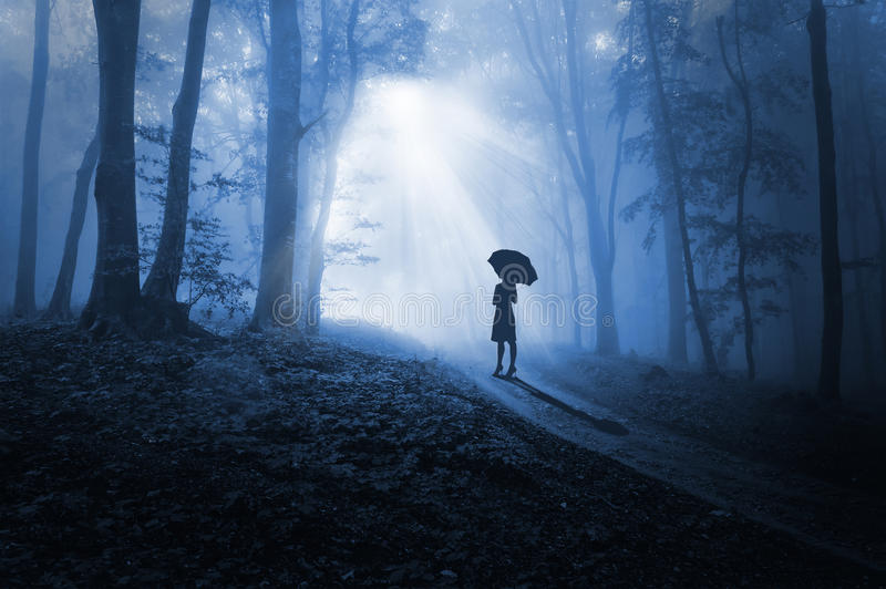 Women facing the light in darkness stock photos