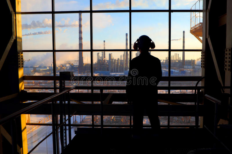 Silhouette of a worker.Industrial business. royalty free stock image