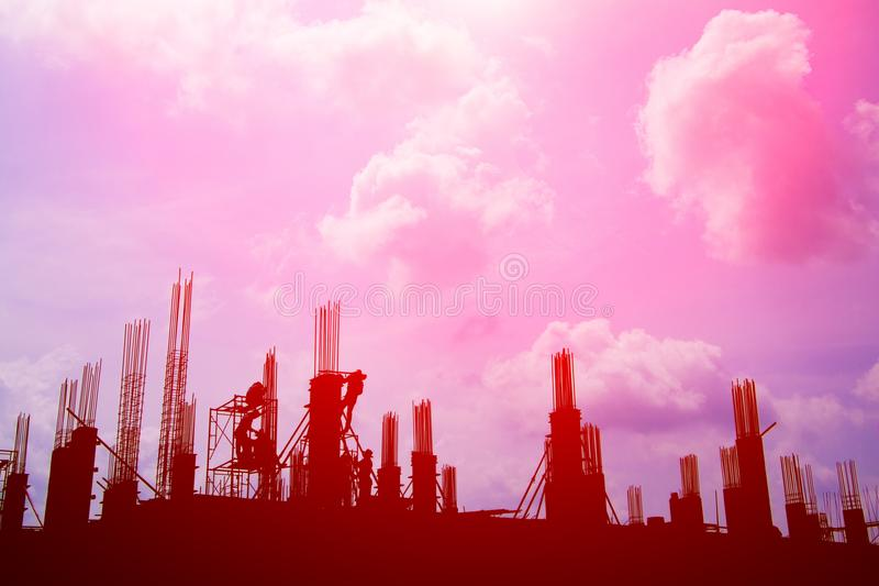 Silhouette worker team working construction site pink sky background with copy space add text stock photos