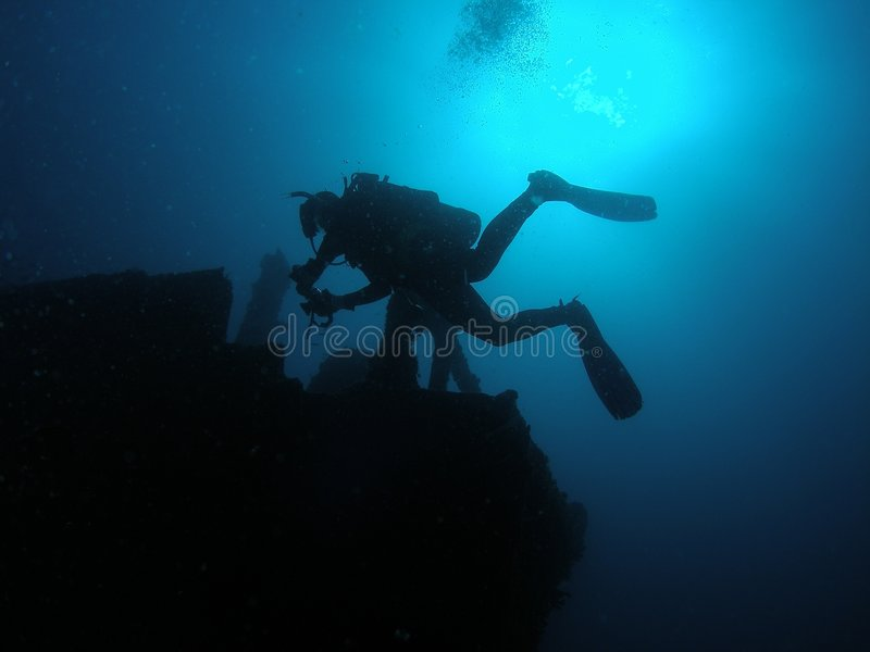 Silhouette wreck diver stock images