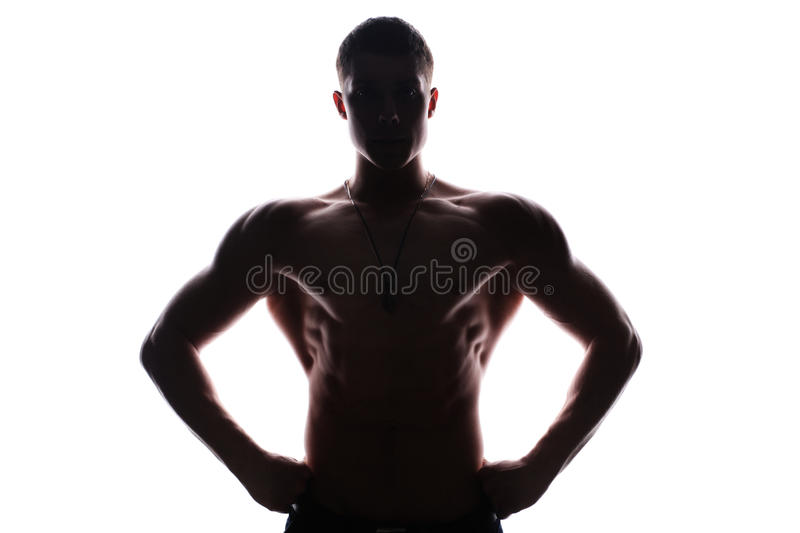 Silhouette of young athlete bodybuilder man stock image