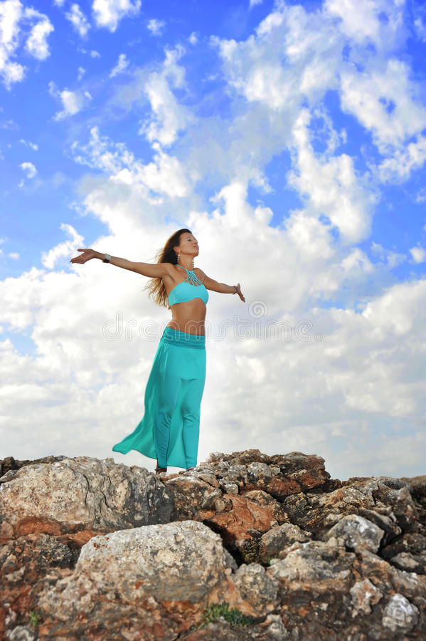 Silhouette of young attractive woman with opened arms outdoors i stock photo