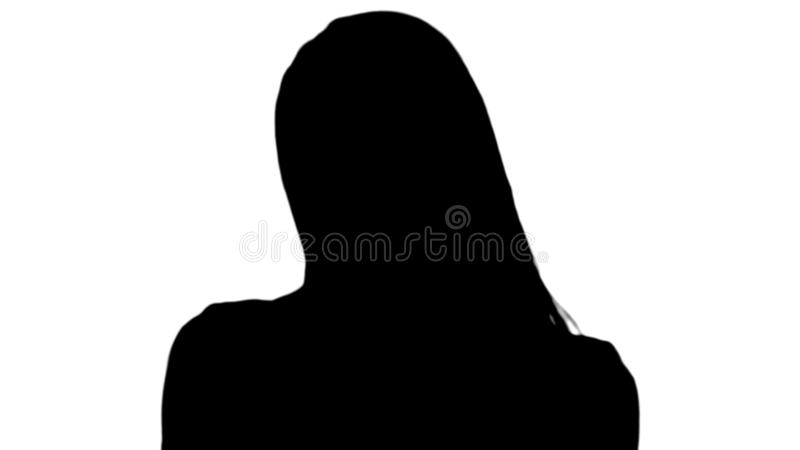 Silhouette Young beautiful lady in pink looking to camera and thinking of something smiling slightly. stock photo