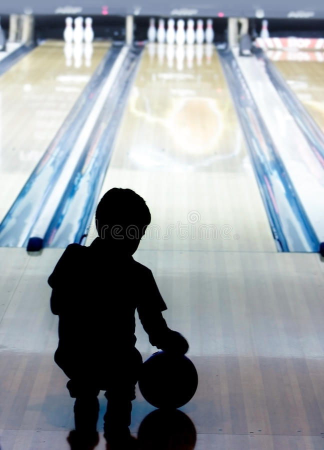 Silhouette Of Young Boy In Bowling Royalty Free Stock Photography