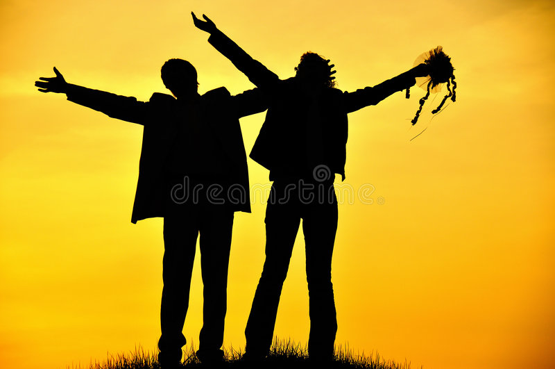 Silhouette of young couple stock photos