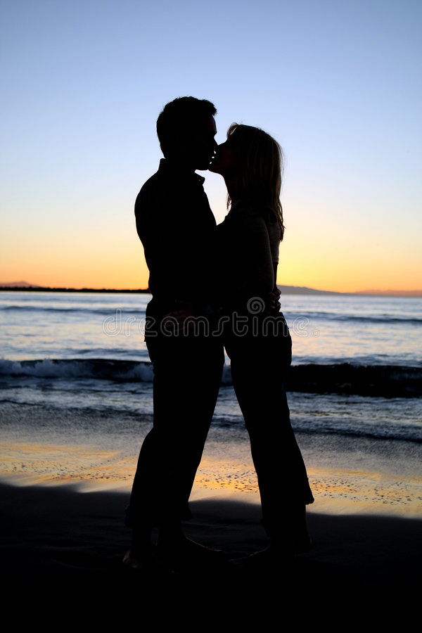 Silhouette of a young couple k royalty free stock photo