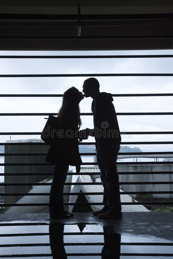Download Silhouette Of Young Couple Kissing Stock Image - Image: 5401889