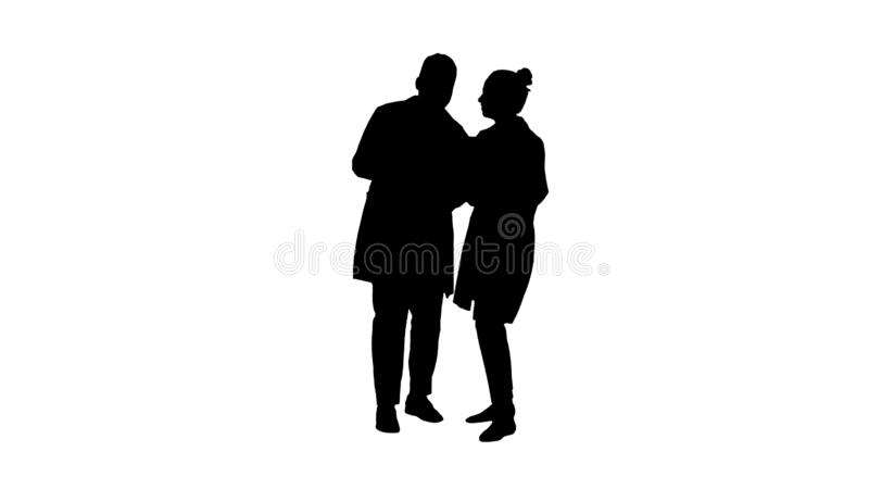 Silhouette Young female doctor and afro american doctor looking at the x-ray picture of lungs. royalty free stock images