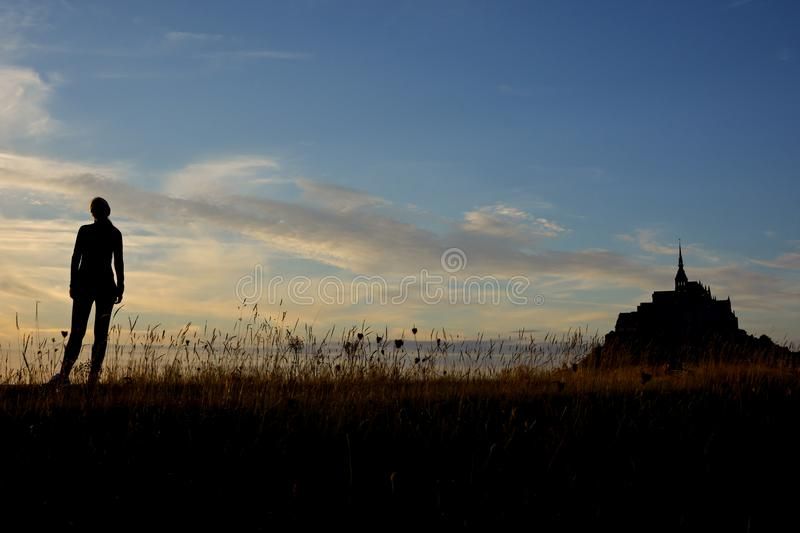 Silhouette of young girl in Normandy stock images