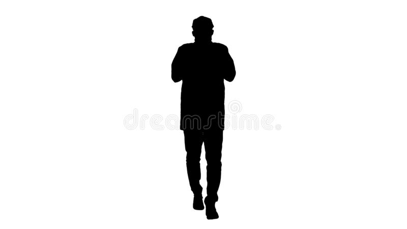 Silhouette Young handsome man walks and buttons up cloak. stock illustration