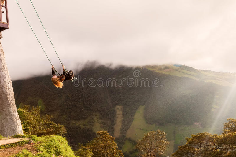 Silhouette Of Young Happy Blonde Woman On A Swing stock image