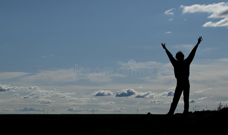 Silhouette Of A Young Happy Man Stock Photo