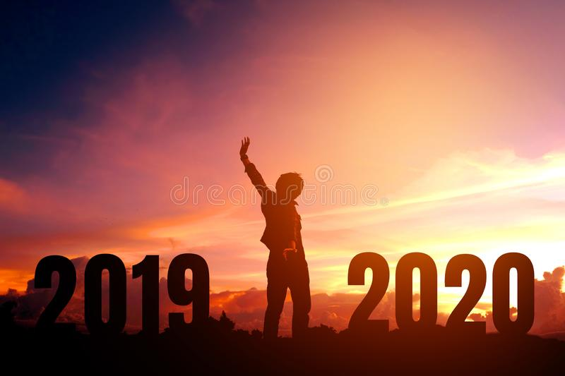 Silhouette young man happy to 2020 new year stock photos