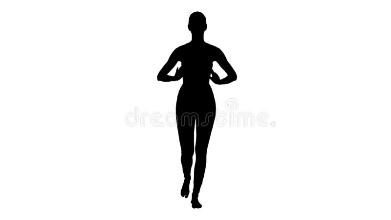 Silhouette Young woman breathing fresh air. Getting ready for yoga. stock image
