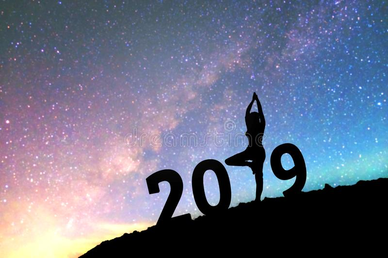 Silhouette young woman Happy yoga for 2019 new year background o stock photography