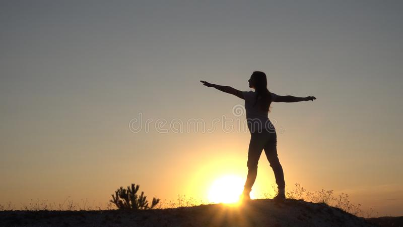 Silhouette young woman practicing yoga and Meditation at sunset stock photos
