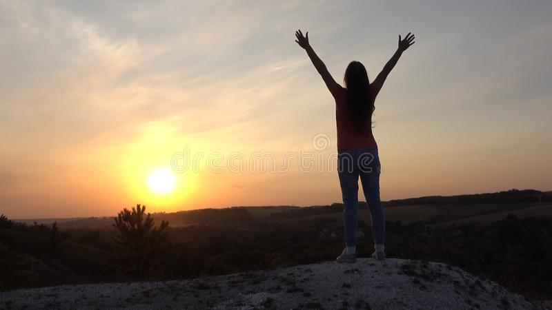 Silhouette young woman practicing yoga and Meditation at sunset royalty free stock image