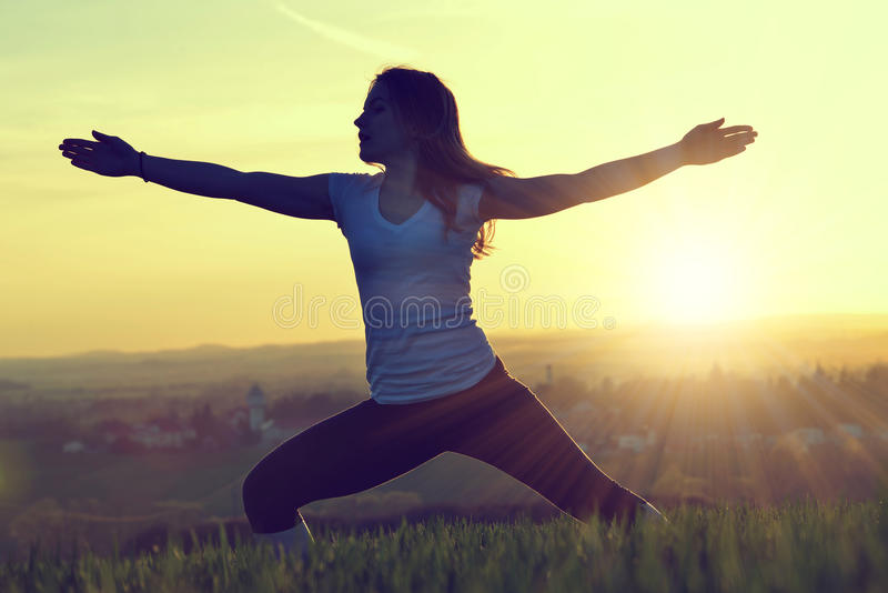 Silhouette of young woman stretching royalty free stock photography