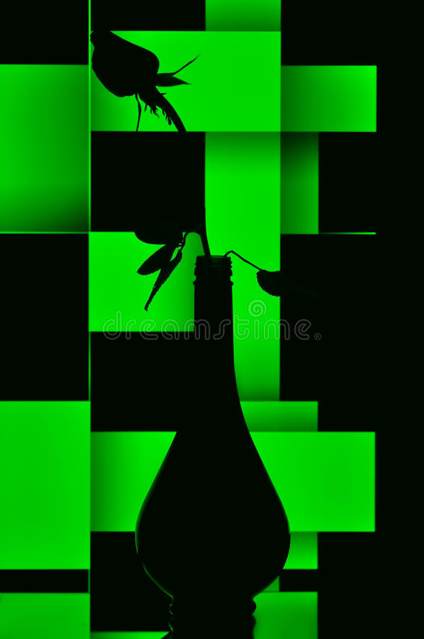 Download Silhouetted Bottle And Rose Bud Stock Photo - Image: 18410266
